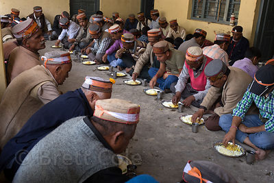 Devotees eat a communal meal at Raghunath Temple during the Dussehra festival in Kullu India