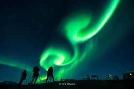 Photographers capturing the Aurora Borealis at the Jökulsárlón Ice Lagoon on the southern coast of Iceland.