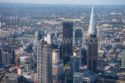 Aerial view of London close up of Financial buildings and River Thames in the background.