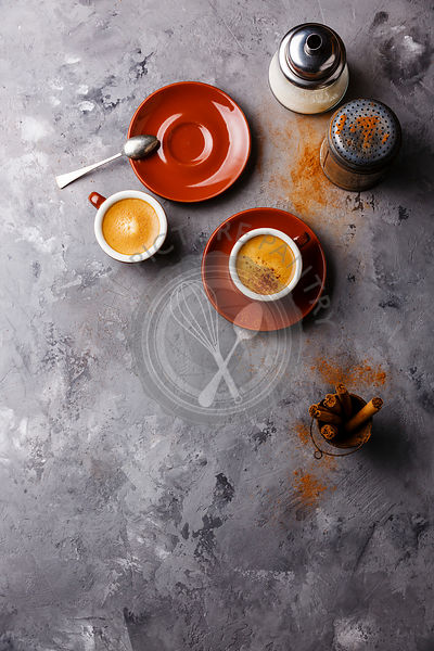 Coffee cup with cinnamon on gray concrete stone background copy space