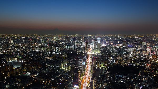 Bird's Eye: Sun Set's Over A Giant Freeway Into Tokyo's Horizon