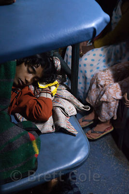 People sleep on a train from Kolkata to Varanasi, India.