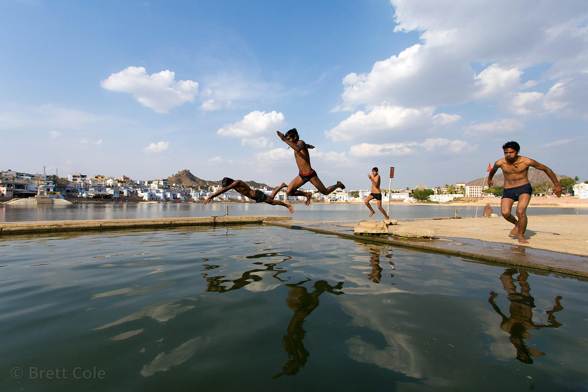 Swimmers in Pushkar Lake, Pushkar, Rajasthan, India