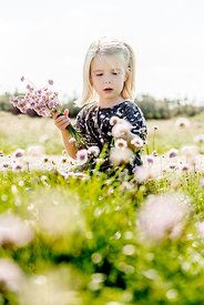 Little girl with flowers 2