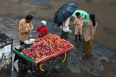 An apple seller at a market in Bandra East, Mumbai, India.
