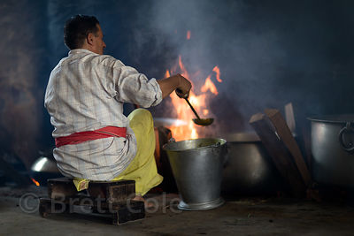 A cook prepares food for a communal meal at Raghunath Temple during the Dussehra festival in Kullu India