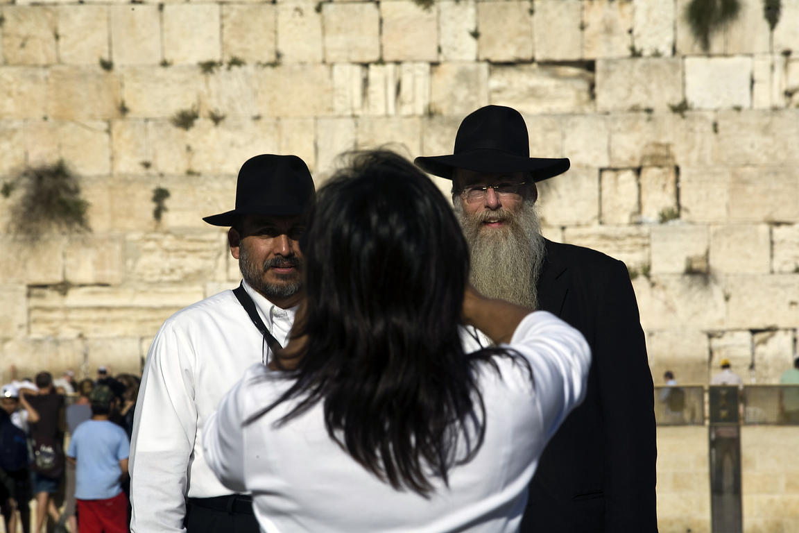 Israel - Jerusalem - A woman photographs two Orthadox Jewish rabbis at the Western ('Wailing') Wall