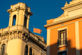 The Senyera, flag of Catalonia, on a building on La Ramble in Barcelona, Spain.