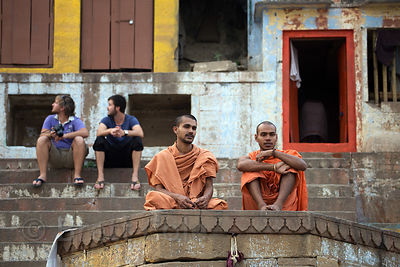 Sadhus and tourists chat, Kedar Ghat, Varanasi, India