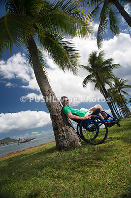 Man in a wheelchair enjoying an Hawaiian coastal park