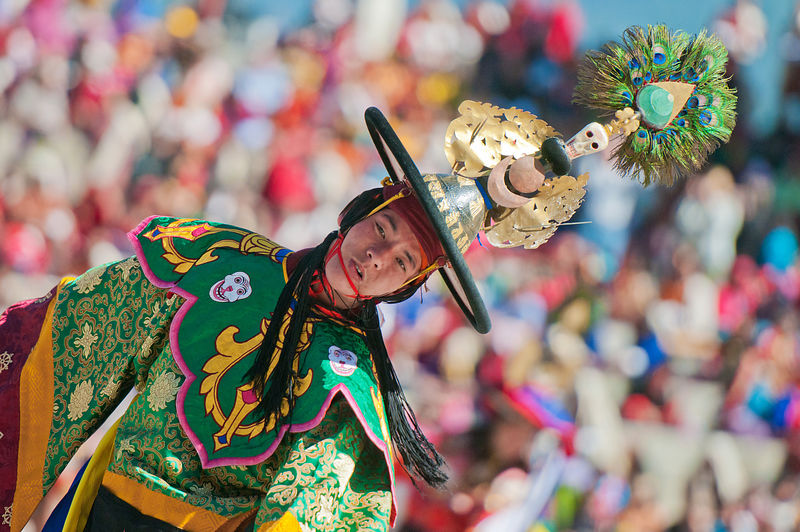 A folk dancer performs during the Thimphu festival. This photograph was shot in a monastery in Bhutan.
