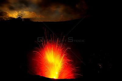 Eruption of Yasur volcano, with full moon just before dawn. Tanna Island, Vanuatu. September 2008.