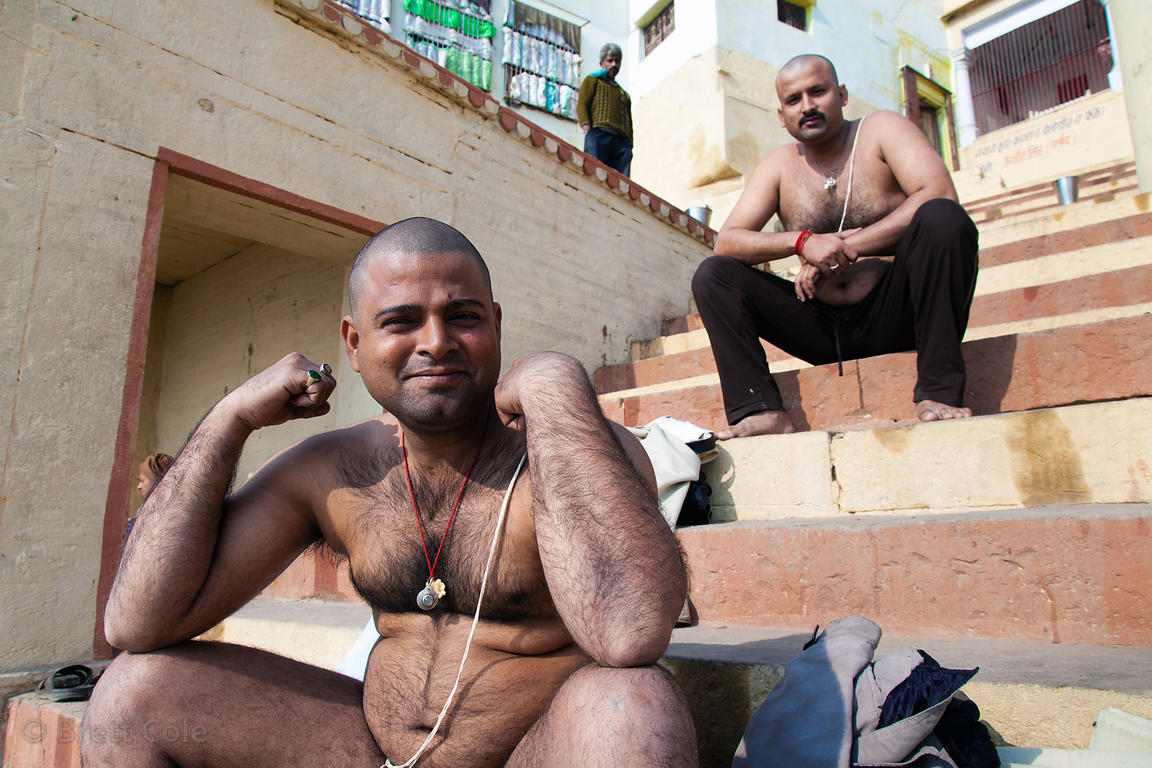 Two Hindu men who have shaved their heads as part of a religious ritual, Varanasi, India.