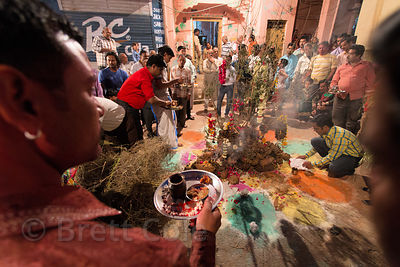 A crowd gets ready to start a bonfire on the obervance of Holika Dahan, Pushkar, Rajasthan, India