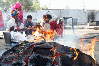Hindus prepare roti at a day of observance for deceased relatives (not Mahalaya, something else, but I don't remember the nam...