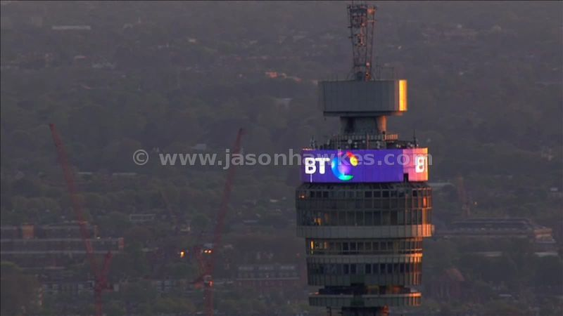 Aerial footage of the BT Tower at dusk, Fitzrovia, London, England, UK