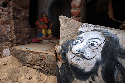 Ganesh idol and Salvador Dali portrait on a backstreet in Pushkar, Rajasthan, India
