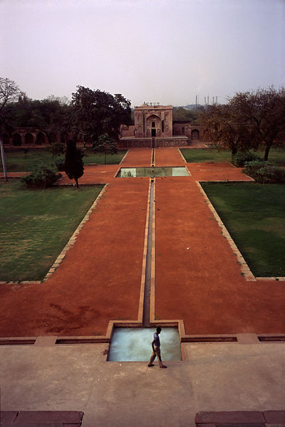 India - Delhi - A man walks past a path at Safdarjung's Tomb