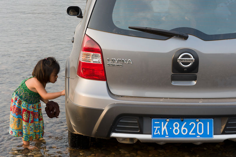 Washing car in Mekong