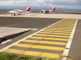 Two small planes parked at the Baltra Airport in the Galapagos, Ecuador.
