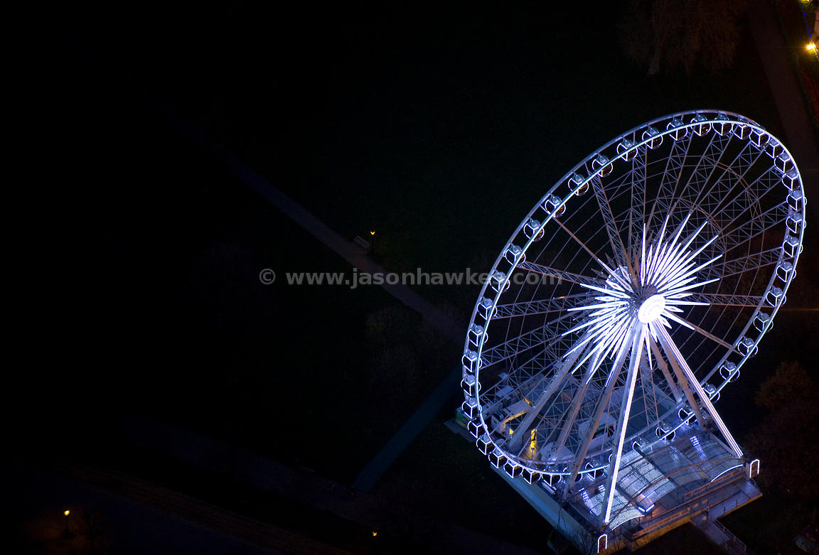 Aerial view over big wheel at night