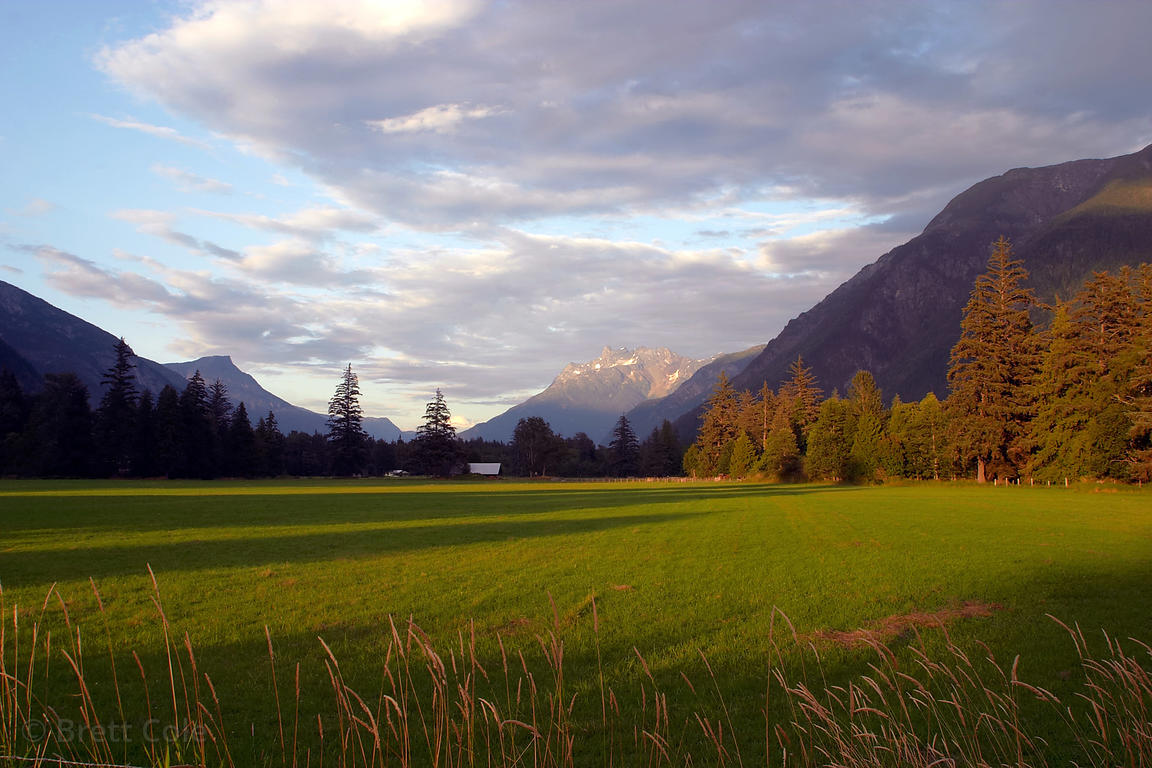 Beautiful eveing light on the bucolic farms of the Bella Coola Valley. Great Bear Rainforest, Nuxalk Territory, British Columbia