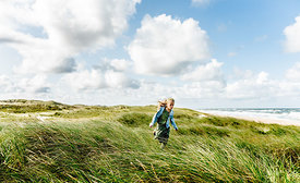 Danish girl running in the dunes in Thy