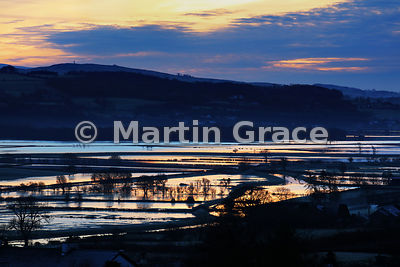 Dawn sunlight reflected in Lyth Valley flood-waters, December 2015, Cumbria, England