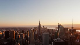 Bird's Eye: Wide Shot Of Manhattan Sunset Over The Empire State Building & Hudson River