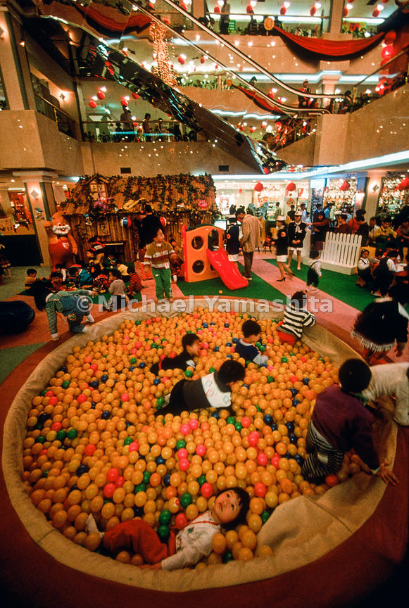 While parents shop, future consumers play at the glittery Qian Cun department store in Guangzhou, capital of Guangdong Province.
