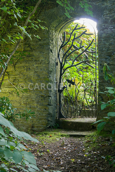 Decorative wrought iron gate in form of tree with bird forms. The Cider House, Buckland Abbey, Yelverton, Devon, UK
