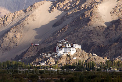 A jumbo jet flies past Spituk Gompa as it makes the precarious looking approach to Leh Airport, Leh, Ladakh, India