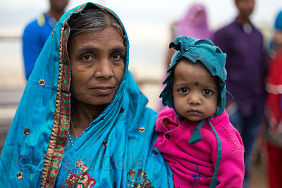 Grandmother and granddaughter show a striking similarity in facial features while displaying fine Pushakr Fashion, Taragarh, ...