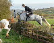 Nick Wright jumping a hedge on Deane Bank
