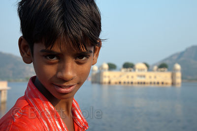 Boy in front of the Lake Palace, Jaipur, Rajasthan, India