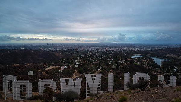 Bird's Eye of The Lighting Of Los Angeles From The Hollywood Sign's Point Of View (Cloud Covered Sunset)