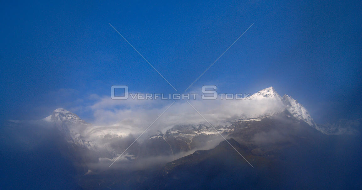 NEPAL Mount Kongde Ri -- Wreathed in cloud, Mount Nupla (left, 5885m) and Mount Konde Ri (right, 6035m) is featured in this i...