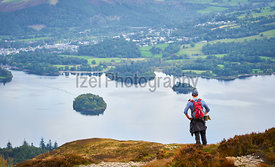LAKE DISTRICT, CUMBRIA, ENGLAND, UK - OCTOBER 08, 2016: A hiker looking out over Derwent Water in the Lake District, England,...