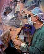 Neurosurgeon operates on brain tumour