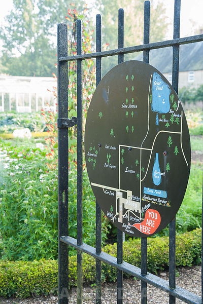 Simple graphic map of the garden painted on a metal roundel, mounted on the gate into the kitchen garden. Forde Abbey, nr Cha...