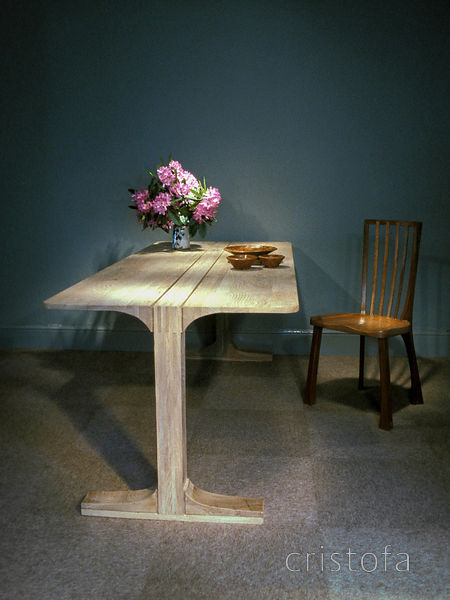 an experimental laminated elm dining table with elm and hyedua chair