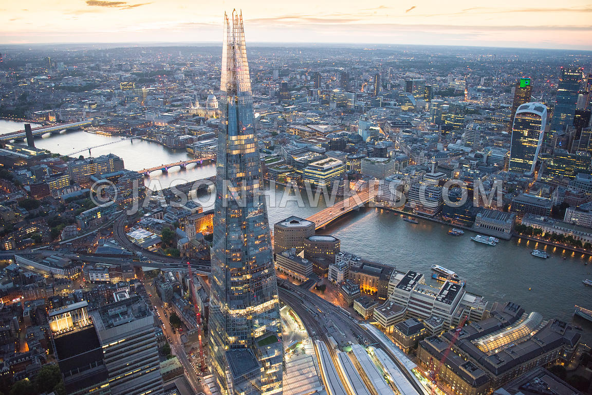 Aerial view of London The Shard towards 20 Fenchurch Street at night.