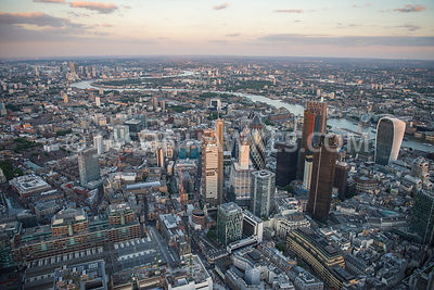 Dsk aerial view over the City of London and Liverpool St Station, looking East, London. 30 St Mary Axe, 94 Middlesex St, 110 ...