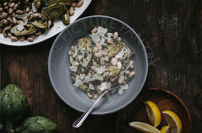 Braised Baby Artichoke Salad with White Beans and Shaved Manchego cheese