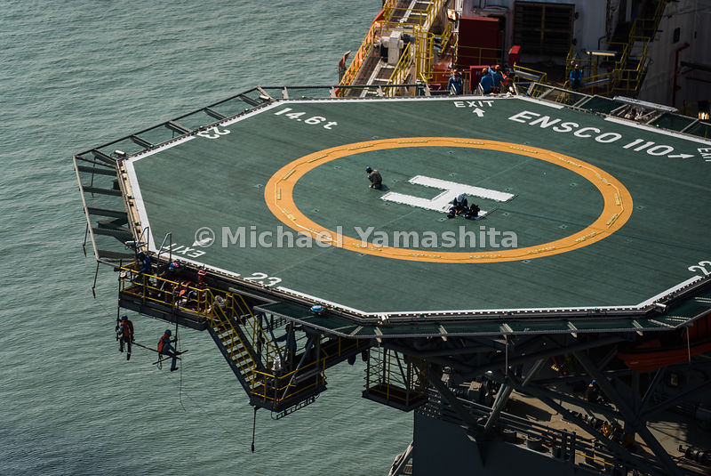 Perched right at the edge of a rig undergoing construction is a helipad that facilitates the primary means of transport to an...