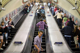 A long escalator at a station of London Underground's Piccadilly Line, London, UK.