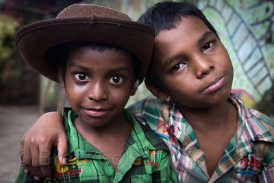 Happy brothers at a shelter at Sealdah Railway Station, Kolkata, India