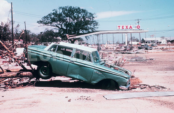 Gas station and car damaged by Hurricane Camille, 1969