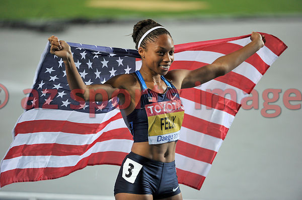 Allyson Felix holds the American flag after she wins the Bronze medal.Allyson Felix 22.42sec. third place at the Iaaf World C...