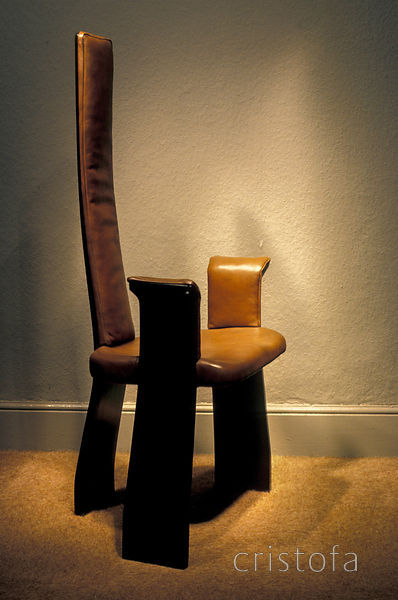 a black lacquered chair with leather
